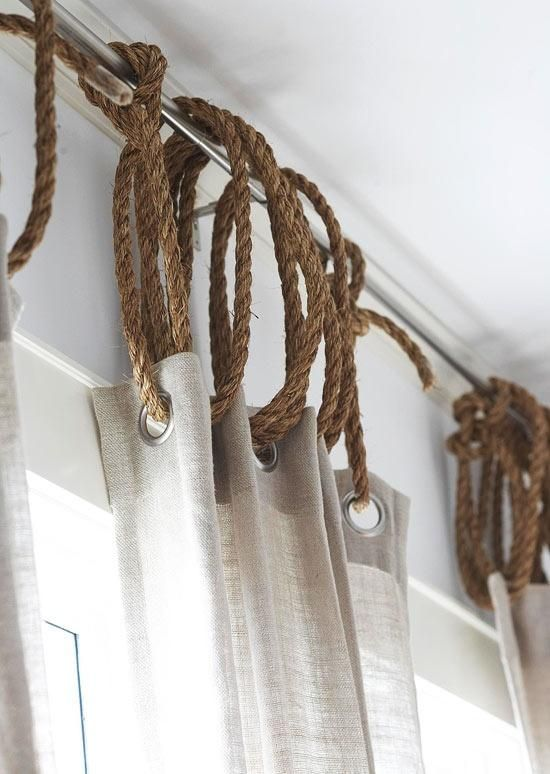 Rope curtain rings with linen curtains, totally doing this!