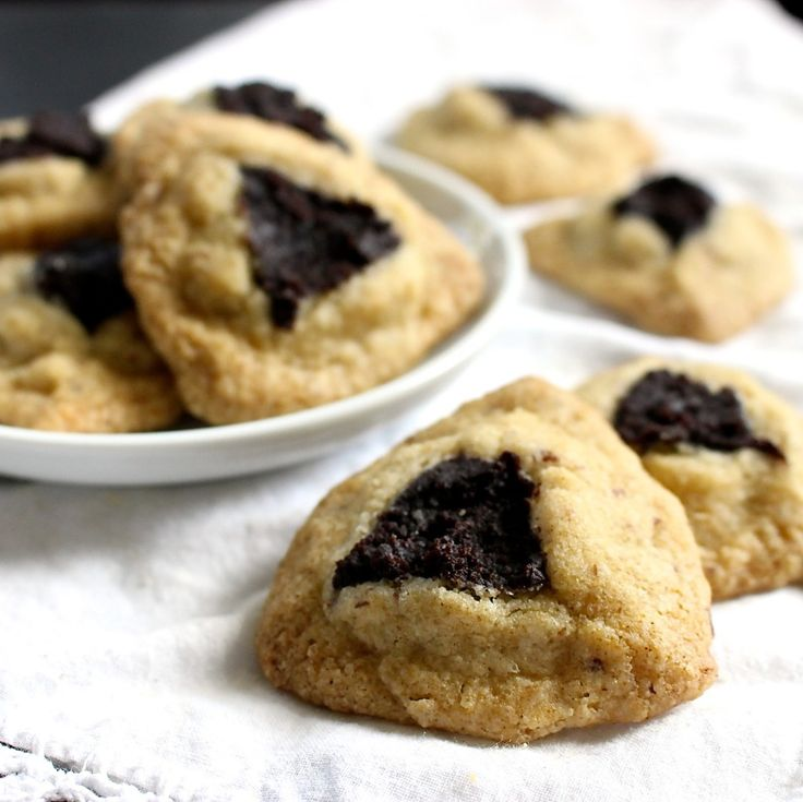 Poppy filling hamantaschen cookies, a traditional cookie we eat on the Jewish holiday Purim. Buttery-ish with sweet poppy seed filling with a whole lot of delicious! Gluten free, dairy free, egg free, soy free. Freezer friendly, and can easily be made ahead too. #purim #holidaycookies