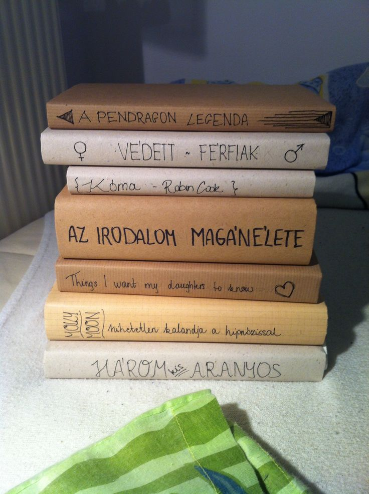 Random books covered in neutral coloured paper - simple style on your shelves!