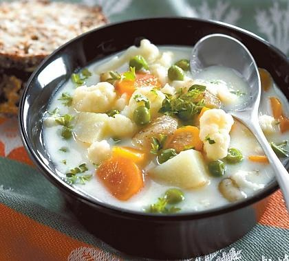 """Kesäkeitto. """"Summer soup"""" with potatoes, carrots, peas, cauliflower..."""