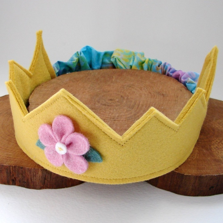 great idea to make crowns that fit many sizes without velcro! - Wool Felt Crown -- golden yellow with pink flower. $18.00, via Etsy.