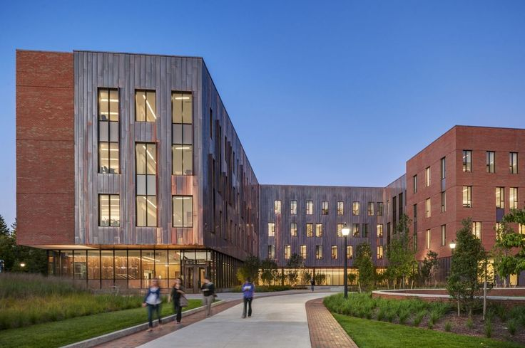 Completed in 2012 in Storrs, United States. Images by Anton Grassl/Esto, Charles Mayer. Located at the center of campus, two new classroom buildings frame the nexus of student interchange where two primary pedestrian paths cross at an...