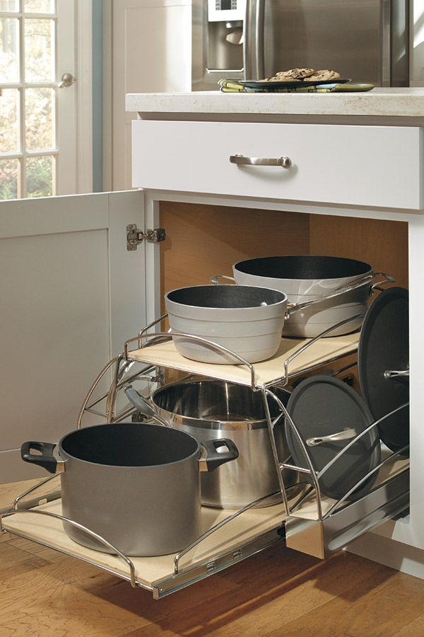 Our Base Pots and Pans Pullout Cabinet has two independent pullout shelves and chrome rack to allow you to organize pots, pans, and lids without hassle.