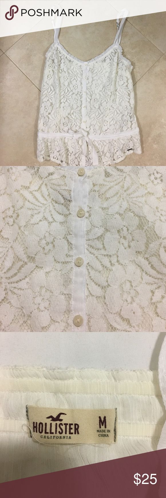 Lace hollister top This couldn't be any cuter! Button up lace Hollister top with tie waist and adjustable straps. It is cream and white. Looks adorable with denim shorts! Worn just once! Hollister Tops Blouses