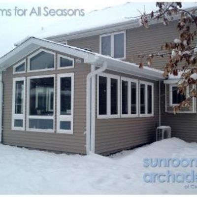 This 4-season room addition in West Des Moines replaced a deck space.  A combination of crank out, fixed and canopy windows by Jeld-Wen surround this cozy room. See interior view next slide.