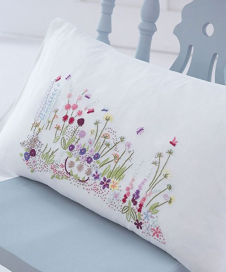 Delightful delicate floral embroidered cushion in pretty colours on white linen Feather pad included 50 x 30