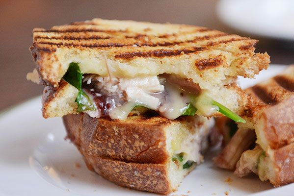 The absolute best way to use Thanksgiving leftovers, this turkey and brie panini with cranberry and spinach is one of my all-time favorite sandwiches!