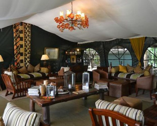 ILKELIANI CAMP- This is a permanent luxury tented camp, nestled in a river glade next to the Masai Mara Game Reserve, the area is a favorite for elephants coming to drink from the Talek River. Accommodation is in 17 tents each commanding views of the plains and the wildlife action throughout the day. The camp blends into the surrounding bush and each tent, with en-suite bathroom and large veranda, over looks the Telek river, where crocodile and hippo may be seen.