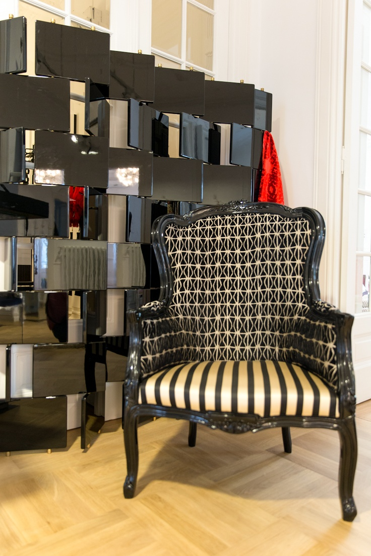 "Elegant Louis XI style armchair. Seat upholstery in Christian Lacroix ""Sol y Sombre"" velvet fabric and backrest upholstery in Christian Lacroix ""Caparcon Jais"" velvet and silk fabric. The frame is hand carved in beech wood finished in black. Price -  $1,956.02 info@artchairs.co.uk  Dimensions  Height -105 cm Foot Stool - 42 cm Seating Width - 72 cm"