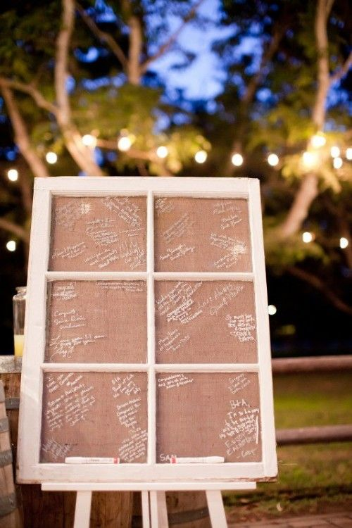 an old vintage window as wedding guest book!Sign on the wood frame... wedding pictures placed in frame