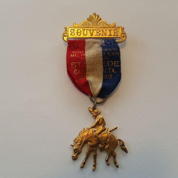 1912 Stampede Souvenir pin with Bucking Bronco.