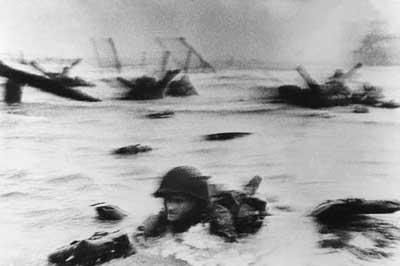 Omaha Beach; Robert Capa, 1944  One of the few surviving images from D-Day, Robert Capa's haunting, blurry image was a brief glimpse for many people into a world of war they might not otherwise understand.