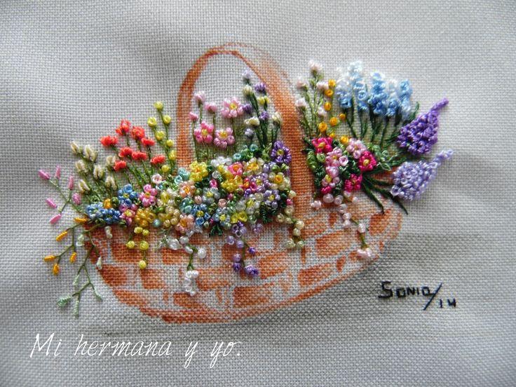 Handmade embroidery, with silk and ribbom over a paint of my creation. Bordados hechos a mano, con ceda y cinta sobre una pintura de mi creacion