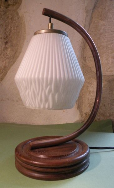 The shade is of very thin glass and original vintage whether the rest of the lamp has been ma