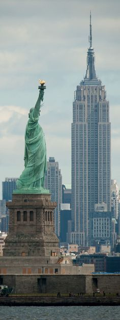Statue of Liberty and The Rockefeller Tower, New York City, New York