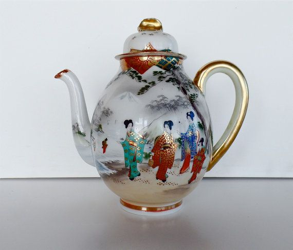 I believe this antique Japanese eggshell porcelain teapot of Grandma's to be moriage from the turn of the century, or Meiji era. https://www.etsy.com/listing/278302620/elaborately-hand-painted-japanese?ref=related-2