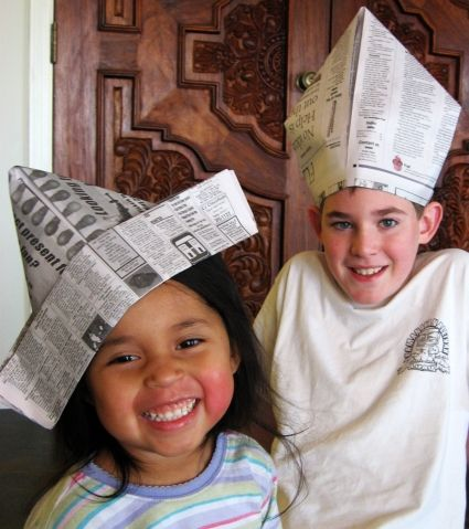 Here is a quick way to make last minute party hats for New Year's Eve.  We made two different styles of newspaper hats. Child's sized Newspaper Party Hat Use a whole sheet of newspaper Fold in half Fold each of the top corners to the center Fold top layer at bottom up Fold it up again Turn newspaper over and fold up bottom Fold it up again (like other side)...