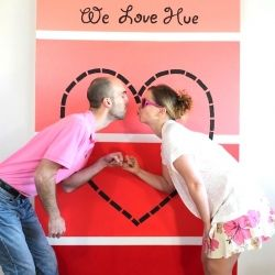 A giant red and pink paint chip serves as a fantastic back drop for Valentines Day photos!