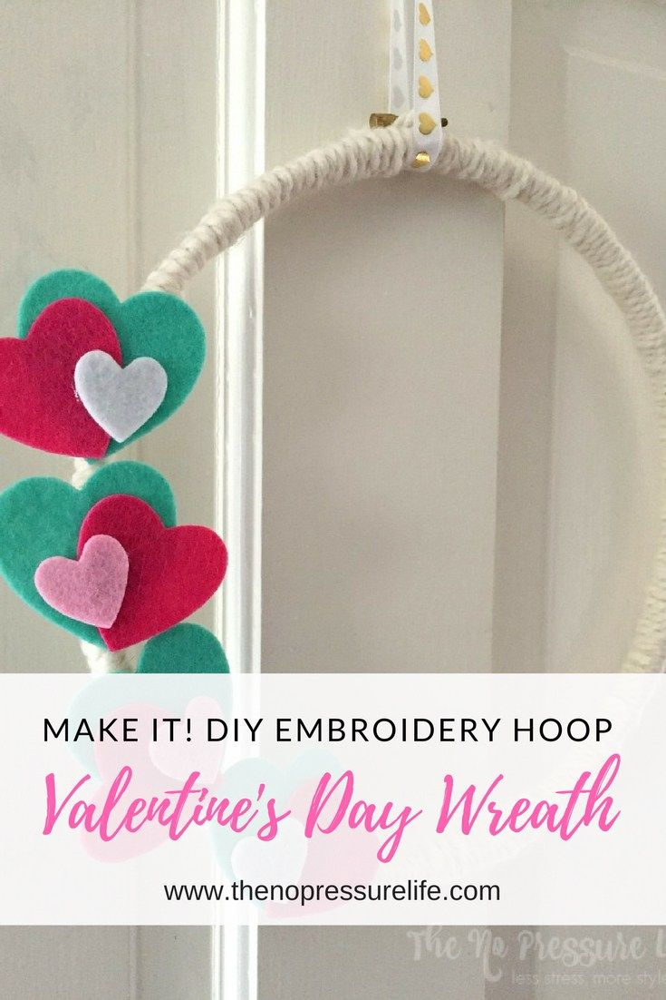 Learn how to make a modern DIY Valentine's Day wreath with an embroidery hoop! This easy and simple decoration is a perfect addition to your Valentine's Day decor if you're looking for new ideas. A few sweet hearts make it a cute addition to your front door. #ValentinesDay #ValentinesDayWreath #ValentinesDayDecor #ValentinesDayDecoration #DIYWreath #Wreath