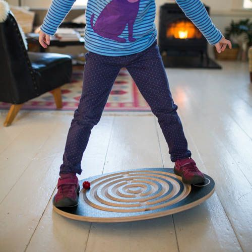Move the wooden balls through the Labyrinth Wooden Balance Board!