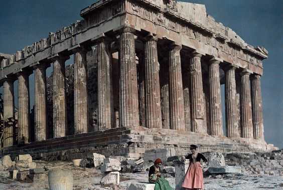 Ladies in old-fashioned, 1930s, clothing, in front of  Parthenon Photo: Maynard Owen Williams, National Geographic.