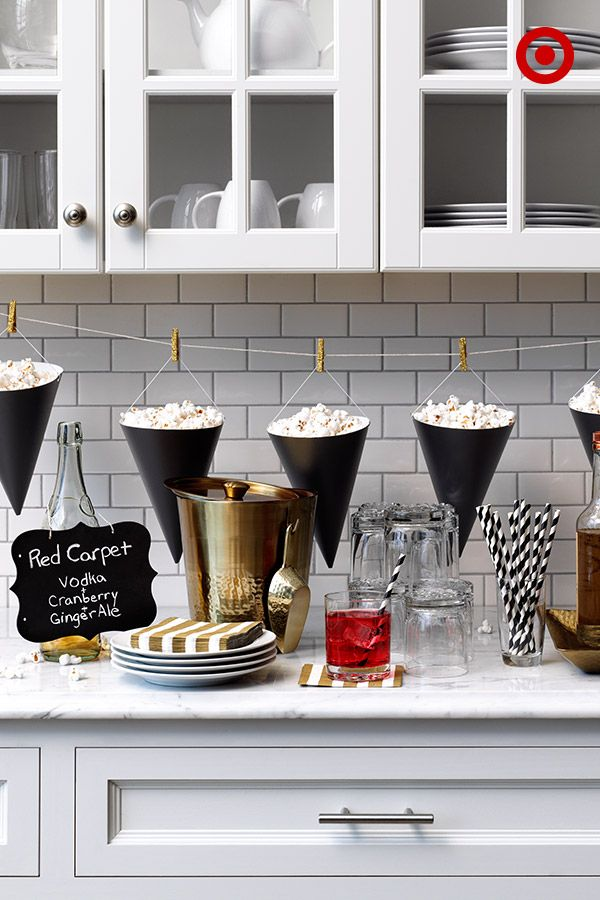 It's easy to pull together a last-minute party: Minimize your work by having guests DIY their own cocktails, serve up popcorn in Spritz party hats and let everyone make their way to a comfy viewing spot.
