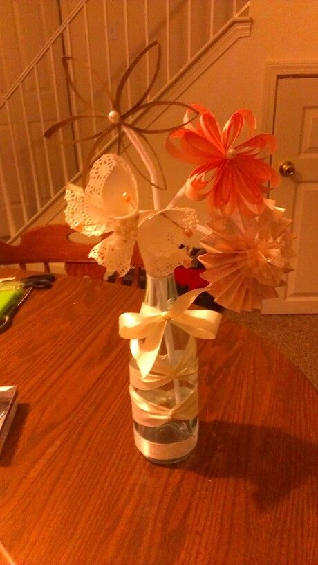 Recycled wedding decorations! This has been a fun and inexpensive way to decorate for my second wedding and get the kids involved.