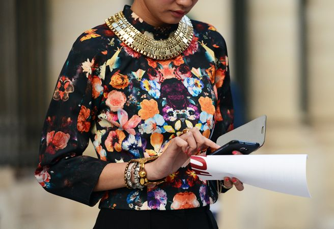 statement gold necklace + printed blouse.