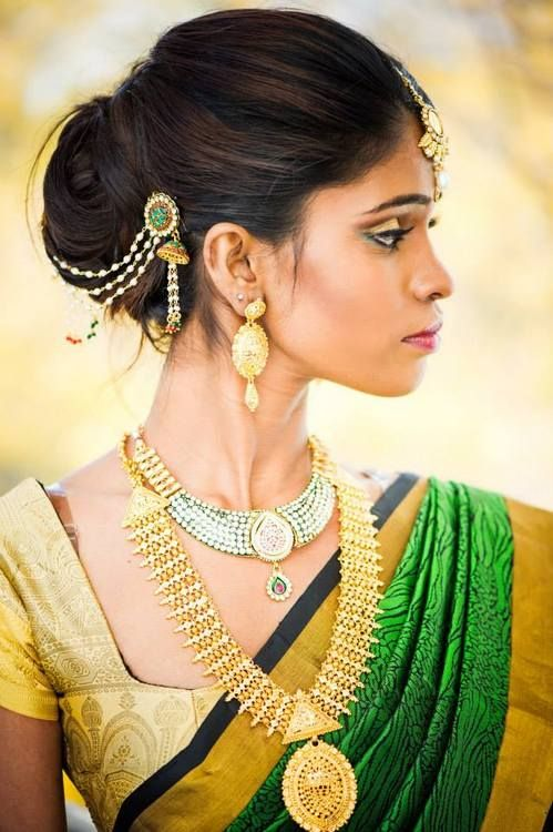 Kanchipuram silk sari teamed with statement necklace and hair accessory