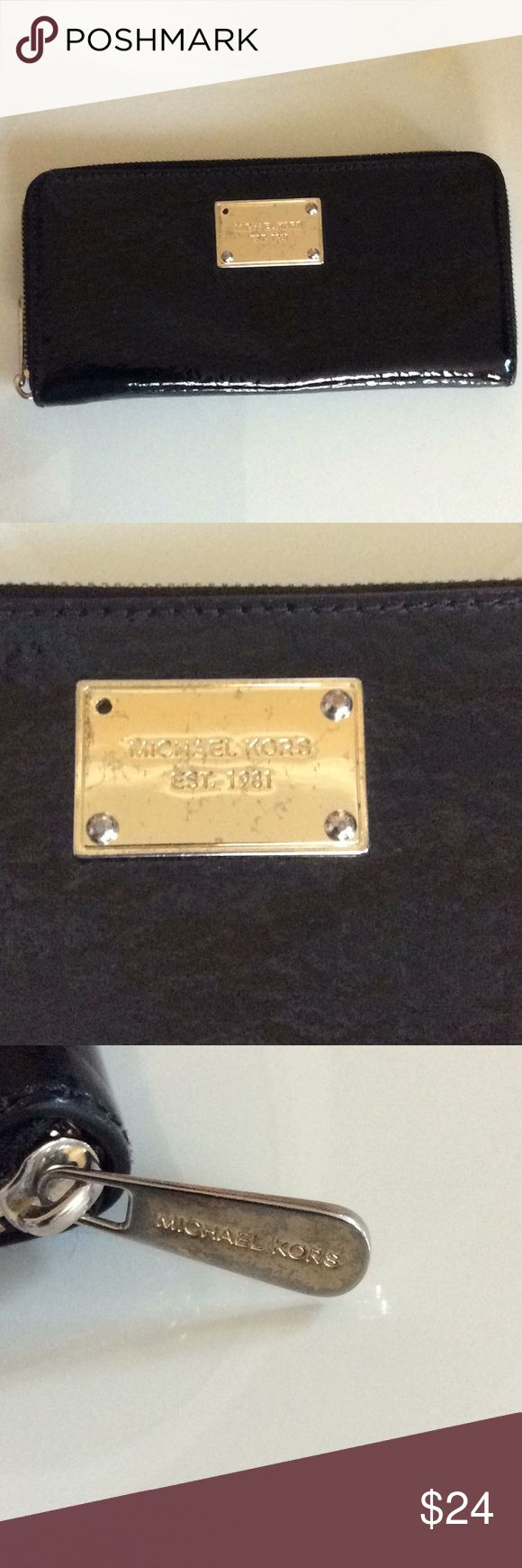 Michael Kors wallet Used Michael Kors wallet. In fair conditions, hardware shows signs of wear- front plate also missing top left screw, there is also a stain on the inside pocket near bottom. Please see picture. Fell free to ask questions or for additional pictures. Due to wear item priced accordingly. MICHAEL Michael Kors Bags