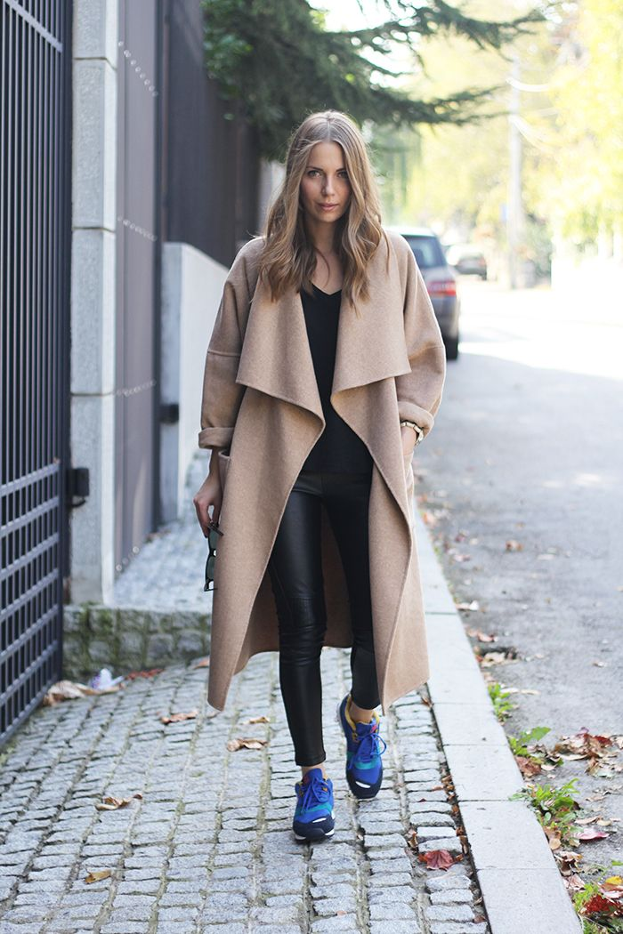 Vanja Milicevic in an oversizec camel coat & blue sneakers #style #fashion