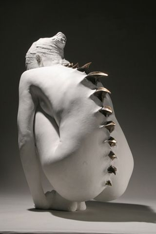 Metamorphosis - I do love this sculpture, reminds me of the Giger designs for Species