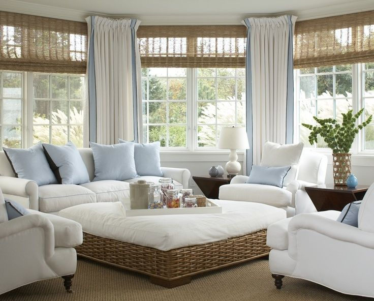Love this beach house living room. Love the combo of woven shades and drapes plus the colors are dreamy.