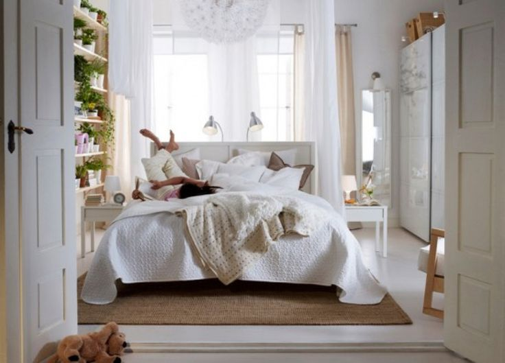Bedroom, : Elegant Cozy White Bedroom With Whte Bed Sheet Combine With Brown Rug On The White Floor Plus Wall Shelves And Double White Door And Decorated With White Curtains