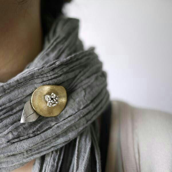 grey scarf with brooch