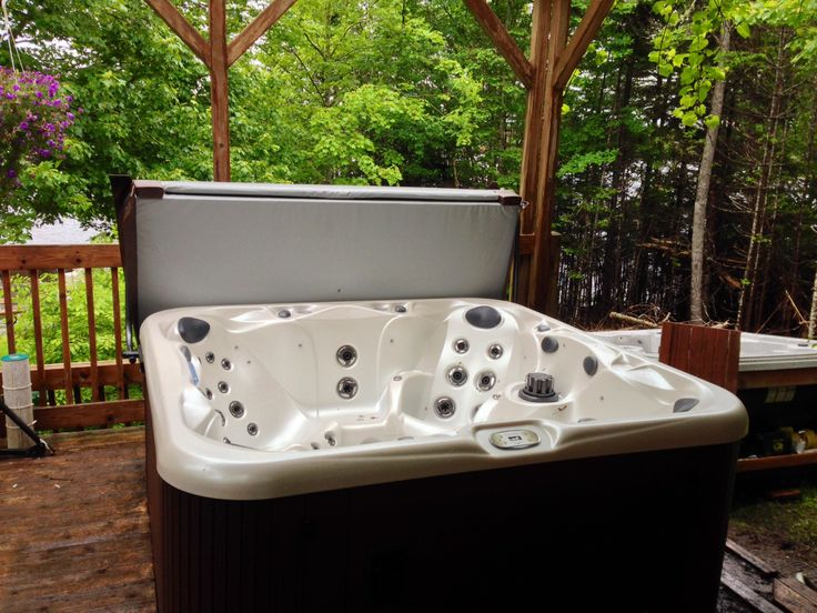 Gorgeous Hot Tub in a beautiful wood gazebo. This stunning S104 Sunrise Spas Hot Tub has been one of our most popular models. The acrylic colour is cameo. Just beautiful here in Halifax, Nova Scotia. www.sparklingpoolsandspas.ca