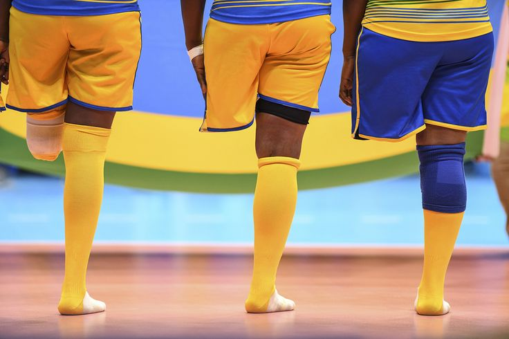 Rwandan sitting volleyball players align for their national anthem before their match against China during the Paralympic Games.