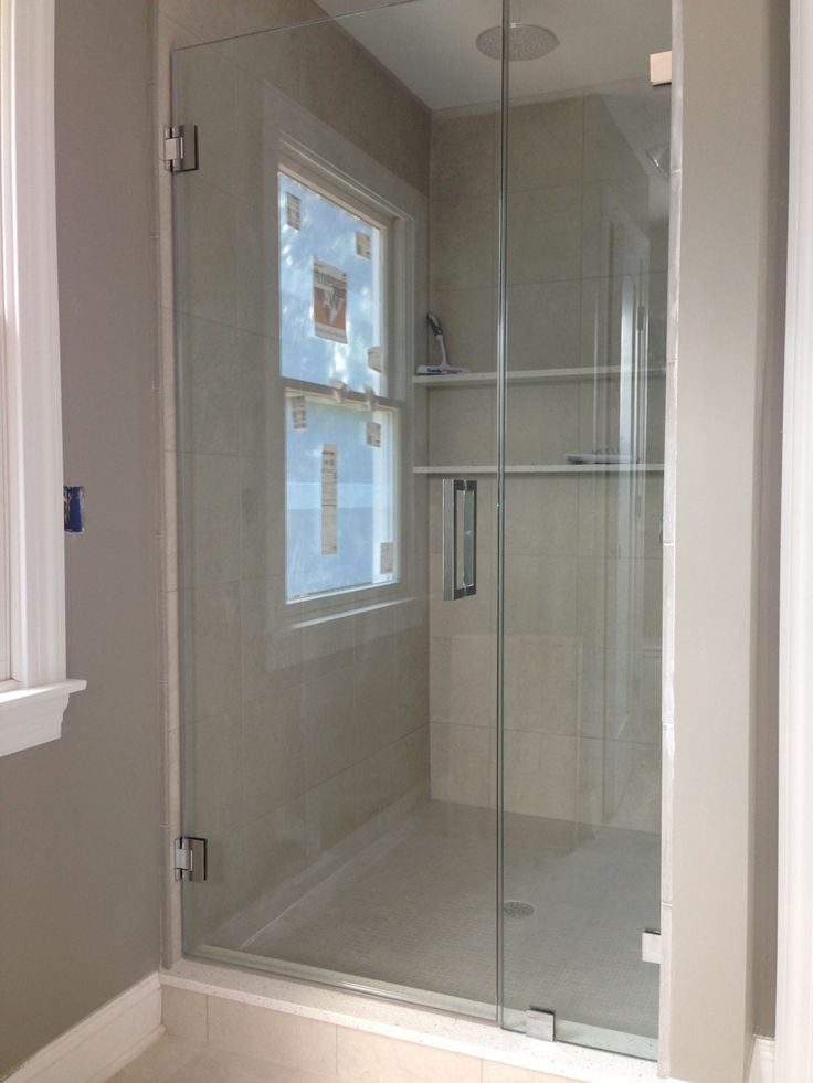 Frameless Shower Door: Single Door with fixed panel with beautiful chrome hardware www.showerman.com Basking Ridge NJ