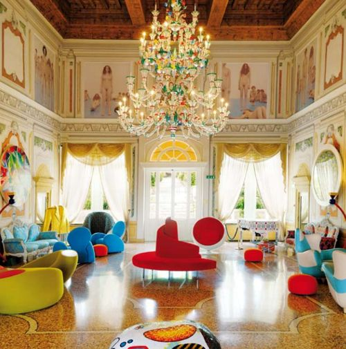 It may look like the most traditional of villas on the outside, but inside the Byblos Art Hotel, located near Verona, Italy, is a glorious blend of Old World meets hot-right-now, for an over-the-top effect of modern madness. Furnishings with Baroque and Napoleonic silhouettes are executed in acid hues, mid-century masterpieces are nestled in front of ornate moldings and wall panels, and formal grounds are dotted with vibrant sculpture.