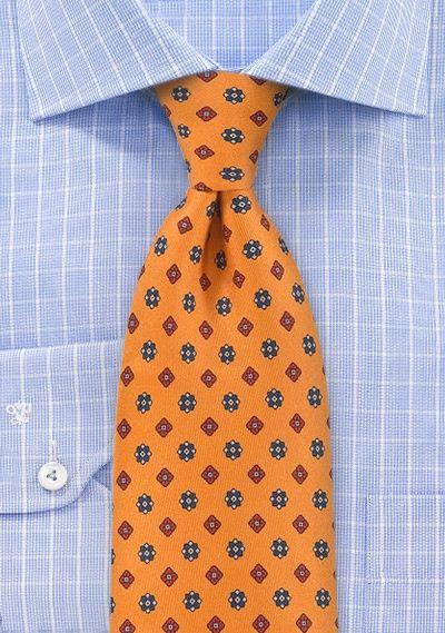Zijden stropdas met zuidelijk oranje bloemmotief http://www.stropdas.org/zijden-stropdas-zuidelijk-oranje-bloemmotief-p-16247.html