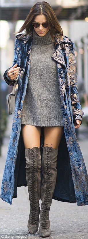 Grey as the weather: The 35-year-old complemented a coin grey For Love And Lemons jumper dress with a pair of fossil grey Le Sila stiletto boots