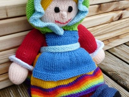 Knitted doll with dress