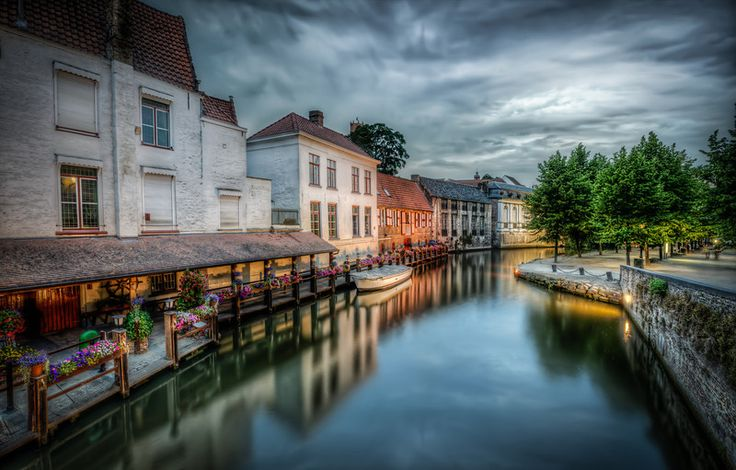 Dramartic sky above a canal in the capital of Chocolate, as Bruge in Belgium is called. The town has a most wonderful picturesque old middle age center with canals and really old buildings. Really worth a visit. Photo by Jacob Surland, www.caughtinpixels.com