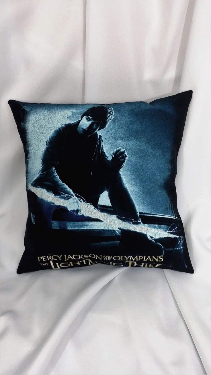 Before the search for the golden fleece there was the Lightning Thief. This movie decor is made from a Percy Jackson & The Olympians tshirt. It has Percy Jackson holding lightning with a blue filter o
