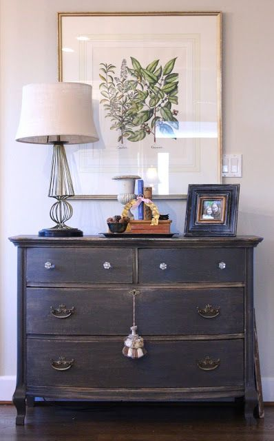 The dresser is newly painted SW Urbane Bronze, sanded to distress it and then it got a tung oil rub down to finish her off.