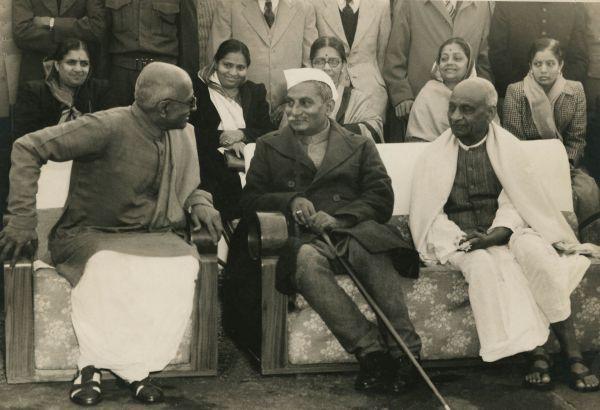 January 1948: C Rajgopalachari and Dr. Rajendra Prasad have a conversation as Sardar Vallabhai Patel watches.