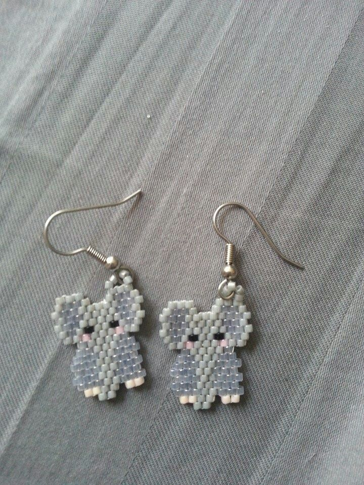 Elephant earrings made in brick stitch by samantha roberge $5 contact simple beads on Facebook if interested