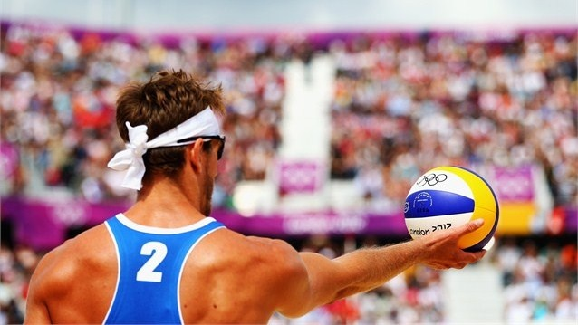 Martin Reader of Canada prepares to serve in the men's Beach Volleyball prelim match - Canada vs. Norway