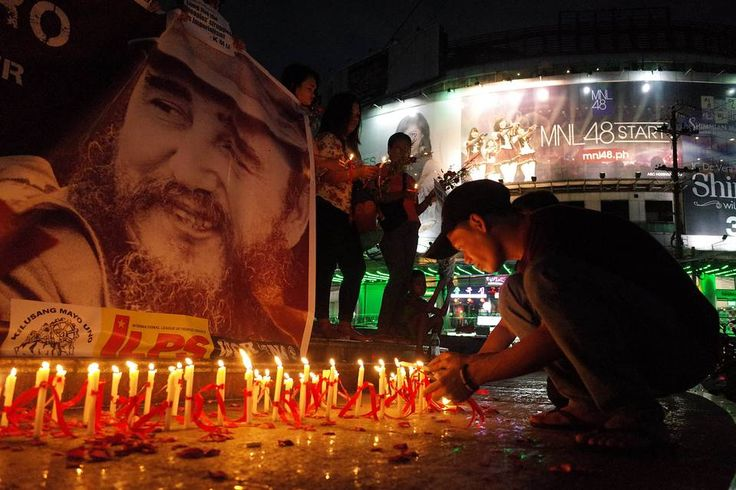 Candles adorn a memorial during a rally in Quezon City, Philippines, to commemorate the life of late Cuban leader Fidel Castro.