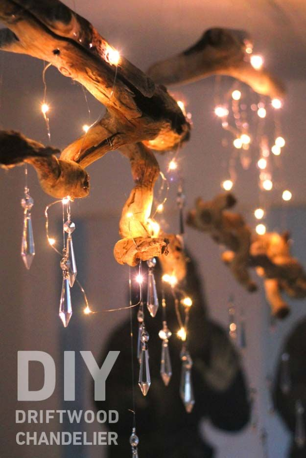 DIY Lighting Ideas and Cool DIY Light Projects for the Home. Chandeliers, lamps, awesome pendants and creative hanging fixtures,  complete with tutorials with instructions | DIY Driftwood Chandelier | http://diyjoy.com/diy-projects-lighting-ideas
